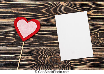 blank card with heart on wooden background