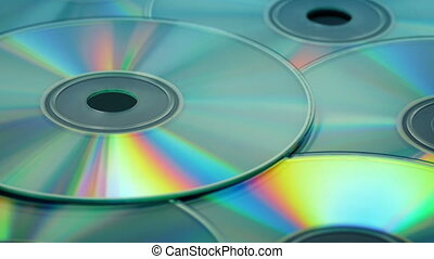 Blank CDs Rotating - CD disk pile rotating closeup