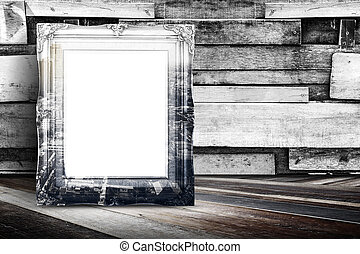 Blank city overlay vintage photo frame leaning at plank wood wall and diagonal wood floor, Mock up for adding your design.