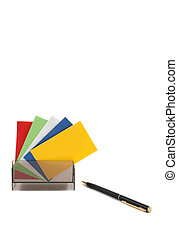 Blank colorful business cards spread out in holder, with pen
