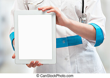 blank computer tablet in the hands of doctor