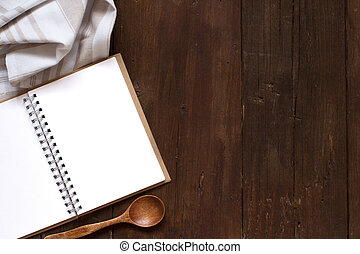 Blank cooking recipe book on a wooden table