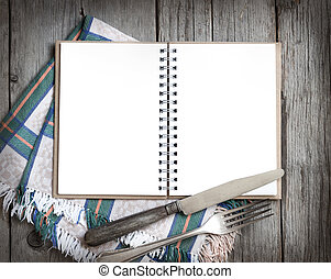 Blank cooking recipe book on wooden table