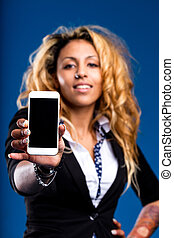 blank COPYSPACE on a smartphone shown by a woman