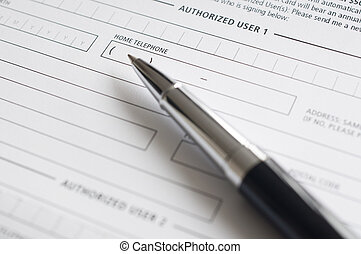 Blank credit application form and pen