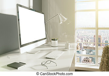Blank desktop of computer with glasses, diary and cup of coffee on the table in modern room