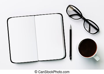 Blank diary, cup of coffee and glasses, on a white background