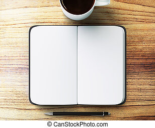 blank diary with pen and cup of coffee on a wooden table