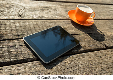 Blank digital tablet and coffee cup