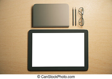 Blank digital tablet screen with diary, pens and eyeglasses on the table, mock up