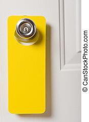 Blank Door Hanger - A blank door hanger on a door, with copy...