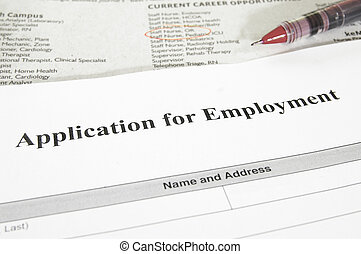 blank employment application and newspaper jobs section