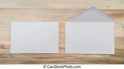 Blank envelopes on  wooden background