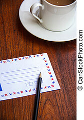 Blank envelopes with pencil and coffee cup