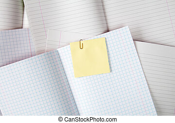 Blank exercise books with sticky note