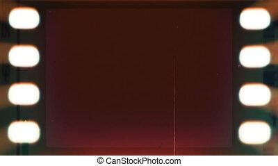 Blank Filmstrip LOOP - Seamless loop of an aged celluloid...