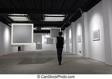 blank frame in art gallery - art gallery, girl look at the...