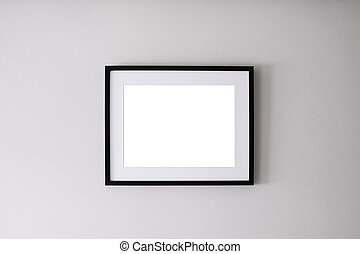 Blank frame on a white wall background