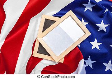 Blank frame on American flag background. Macro photo. Close up.