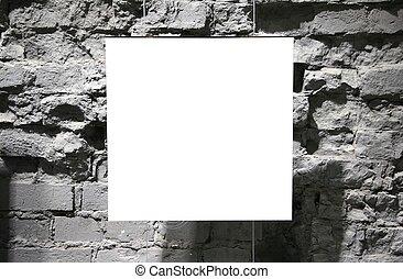 blank frame on grey brick wall