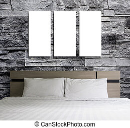 Blank frame on stone wall in the bedroom