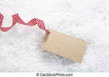 Blank gift tag in snow