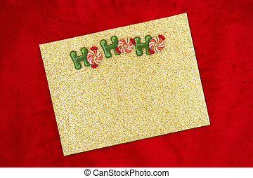 Blank gold glitter greeting card with mints on red plush ...