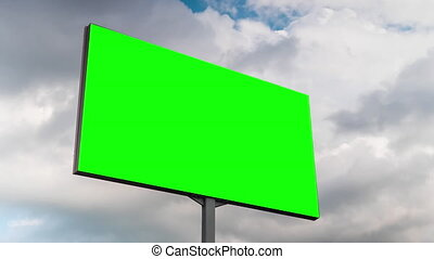 Green screen, consumerism, time lapse, advertising, template, mock up, copyspace, chroma key concept. Timelapse - blank green billboard or large display and moving white clouds against blue sky