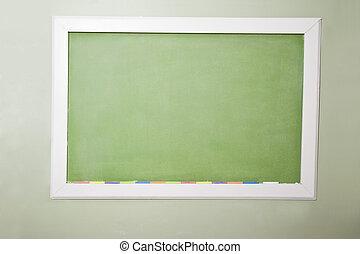Blank green blackboard and chalk - Back to school - blank ...