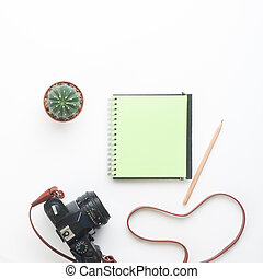 Blank green color notebook and camera on white background, Summer lifestyle concept