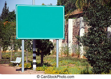 A Blank green Sign by the high way