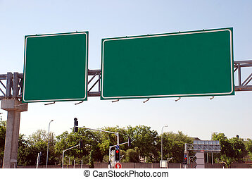 Blank green high way Sign - A Blank green Sign by the high...