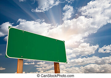 Blank Green Road Sign Over Clouds and Sunburst - Blank Green...