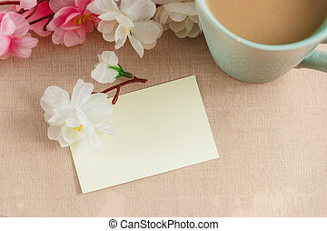 blank greeting card with flowers bouquet on white wooden background
