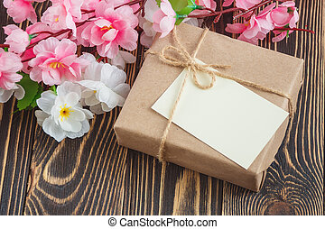 blank greeting card with flowers bouquet on wooden background