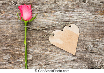 Blank heart shaped tag and single rose