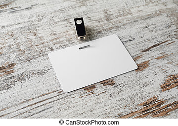 blank id card badge on laptop notebook