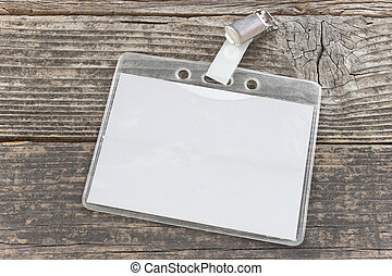 Blank ID card tag on old wooden background