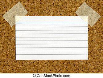 Blank index card stick to a cork notice board.