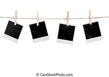 Blank instant photo hanging on the clothesline. Isolated on...