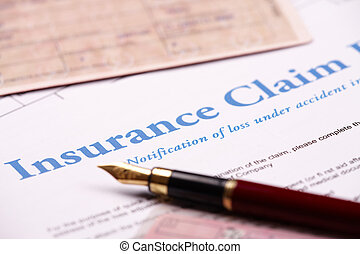 Blank insurance claim form and other papers like ID or ...