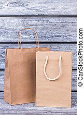 Blank kraft paper shopping bags.