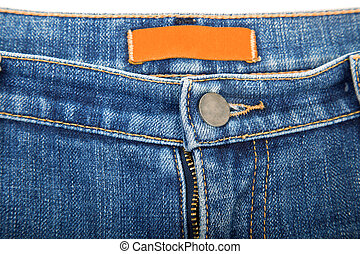 blank label on used blue jeans