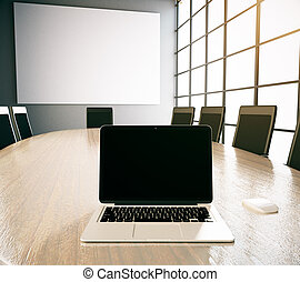 Blank laptop and poster