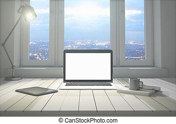 Blank laptop at night