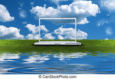 blank laptop computer on the green grass isolated on a white