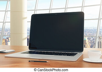 Blank laptop on the desktop in a modern office with cup of...