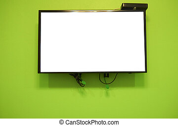 Blank LCD TV hanging at the green wall