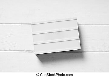 blank light box sign on white wooden background