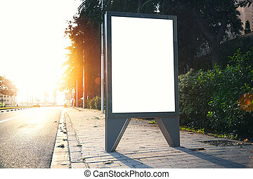 Blank lightbox on the city streets. Horizontal. Sunlight effect